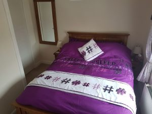 Luxury country holiday cottage in Suffolk - main bedroom with fluffy duvet